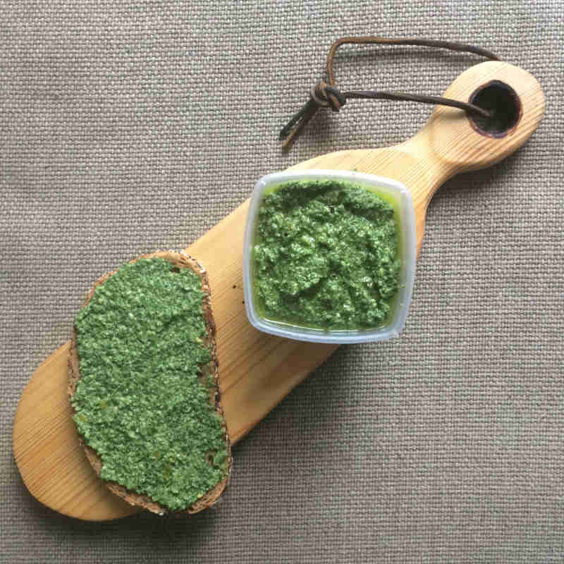dandelion and nettle pesto recipe on bread and board